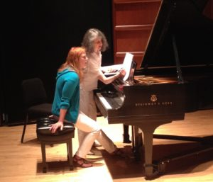Madeline Bruser working with summer participant